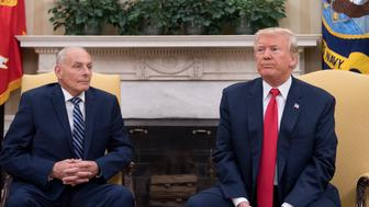 US President Donald Trump (R) speaks with newly sworn-in White House Chief of Staff John Kelly at the White House in Washington, DC, on July 31, 2017.   US President Trump on July 28, 2017 announced via Twitter that he had picked Kelly to replace outgoing chief of staff Reince Priebus, rumored for weeks to be on the verge of being sacked. The chief of staff traditionally manages the president's schedule and is the highest ranking White House employee, deciding who has access to the president.   / AFP PHOTO / JIM WATSON        (Photo credit should read JIM WATSON/AFP/Getty Images)