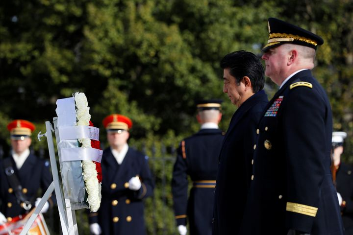 Japanese Prime Minister Shinzo Abe, accompanied by Maj. Gen. Mark Inch, lays a wreath at the Tomb of the Unknown Solider at A
