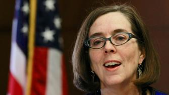Oregon Governor Kate Brown speaks at the state capital building in Salem, Oregon, February 20, 2015. Brown, a liberal Democrat from Portland, outlined her policy agenda on Friday in her first media event since she took the helm of the Pacific Northwest state to replace John Kitzhaber, whose decades-long political career dissolved in the wake of an influence-peddling scandal involving his fiancee. REUTERS/Steve Dipaola (UNITED STATES - Tags: POLITICS)