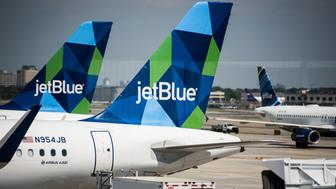 A JetBlue Airways Corp. Airbus A321 plane sits at a gate outside of Terminal 5 at John F. Kennedy International Airport (JFK) in New York, U.S., on Wednesday, July 12, 2017. Jetblue Airways Corp. is scheduled to release earnings figures on July 25. Photographer: Mark Kauzlarich/Bloomberg via Getty Images