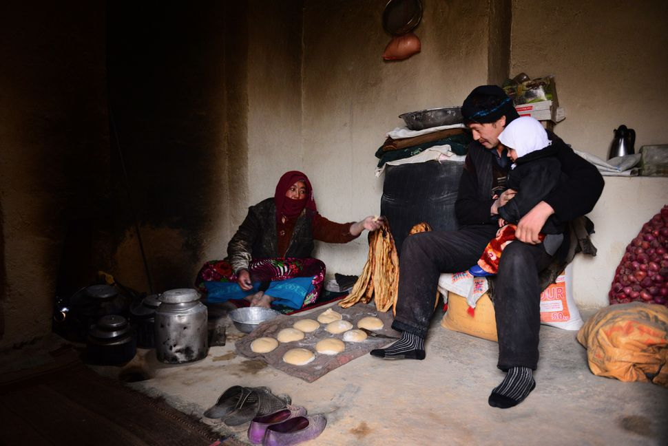Feroza, 30, lives with her small family in the Yakawlang subdistrict in Bamyan. Every other day, she bakes bread in her tradi