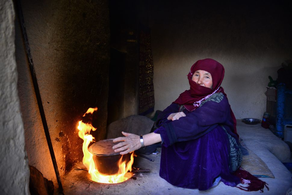 Razia, 50, lives in the Yakawlang district of Bamiyan Province. Throughout the year, she cooks for her family with a traditio