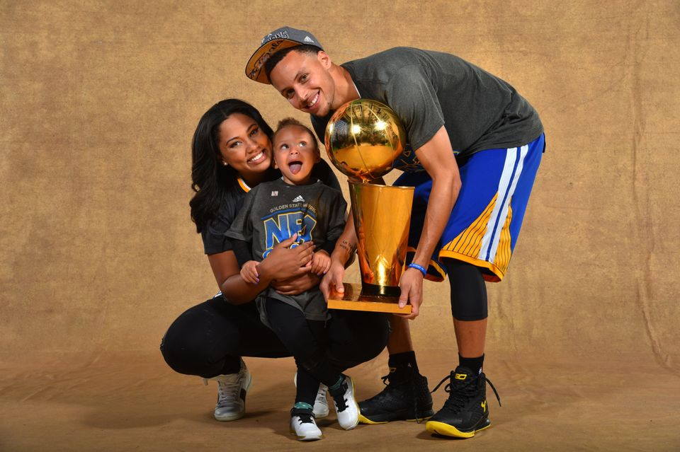 CLEVELAND, OH - JUNE 16: Ayesha Curry, Riley Curry and Stephen Curry #30 of the Golden State Warriors poses for a portrait wi