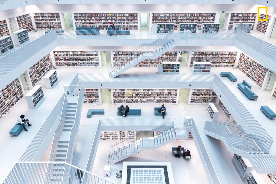 """The modern interior of the city library in Stuttgart. With its wide-open space in the center, where natural light comes from"