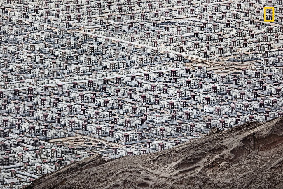 """""""New buildings rise from the desert floor near Al Ain in the United Arab Emirates."""" ― <a href=""""http://yourshot.nationalgeogra"""