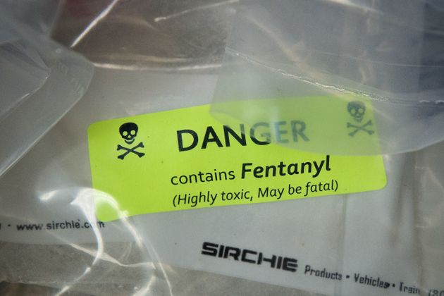 Bags of heroin, some laced with fentanyl, are displayed before a press conference regarding a major drug...
