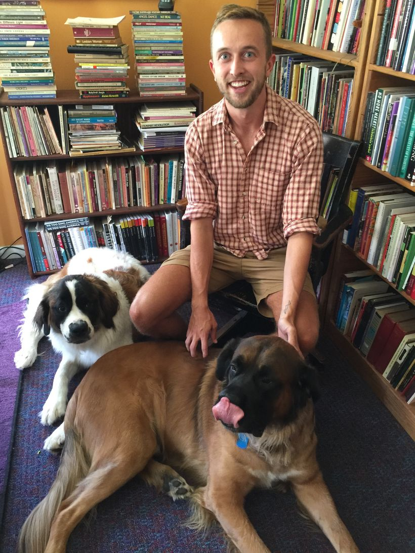 Zane DeZeeuw, summer intern, in the Sinister Wisdom offices with Samantha on the left and Tiberius (with his tongue out) on t