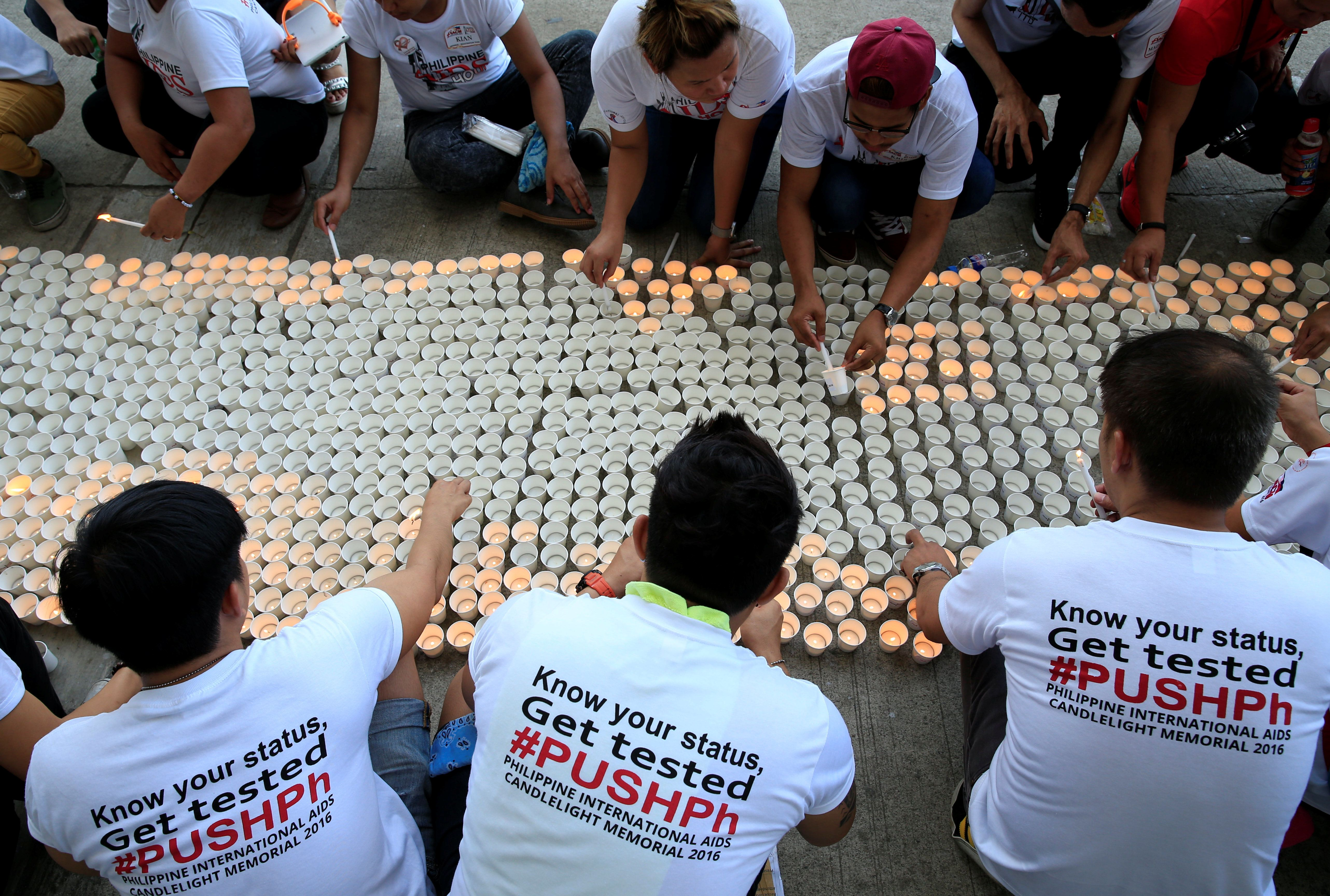 Campaign supporters lights on around 1,638 candles representing the number of dead victims claimed by HIV/AIDS in the Philippines since 1984 as part of their commemoration of International AIDS Candlelight Memorial Day in Quezon city, metro Manila in the Philippines May 14, 2016. REUTERS/Romeo Ranoco