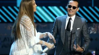 LAS VEGAS, NV - NOVEMBER 17:  Jennifer Lopez (R) and Marc Anthony perform onstage during the 17th Annual Latin Grammy Awards held at T-Mobile Arena on November 17, 2016 in Las Vegas, Nevada.  (Photo by Michael Tran/FilmMagic)