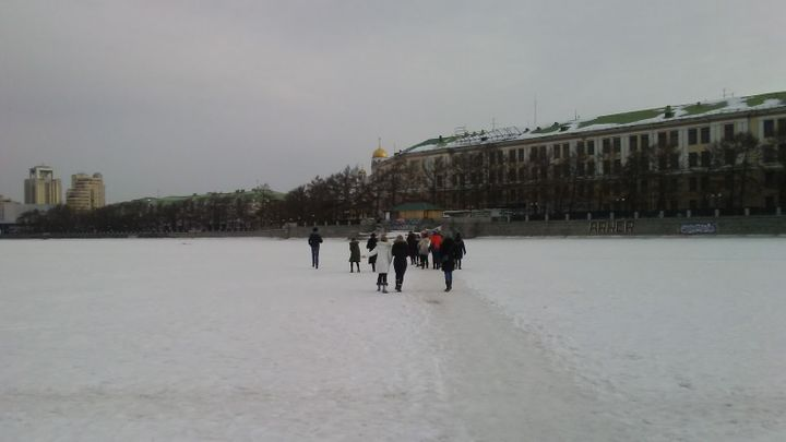 Students cross the frozen Iset River that runs through the city of Yekaterinburg in Western Siberia.