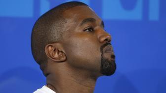 Rapper Kanye West arrives at the 2016 MTV Video Music Awards in New York, U.S., August 28, 2016.  REUTERS/Eduardo Munoz
