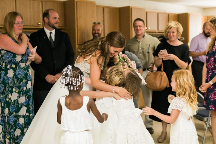 "The bride teaches a kindergarten/first grade combination class. ""Half of the students I have had in my class for two years and the other half I have again this year,"" she explained."