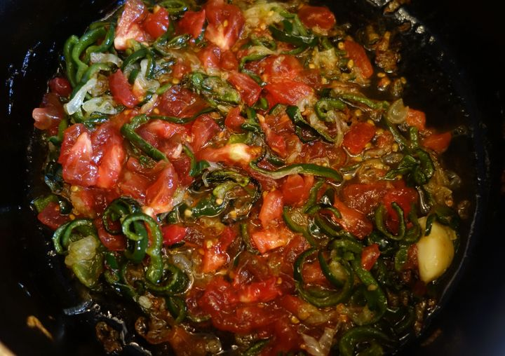 <p>That chopped tomato goes in once the vegetables are thoroughly cooked</p>