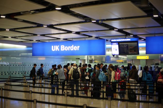 Passengers queue for theUK Border at Heathrow