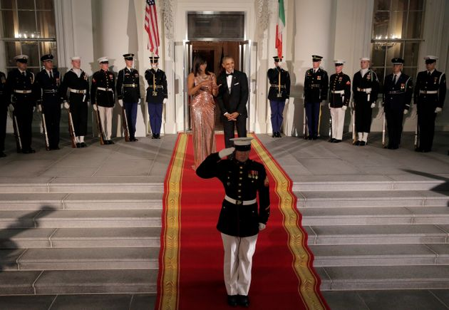 Former President Barack Obama and First Lady Michelle on the steps of the White House awaiting the arrival...