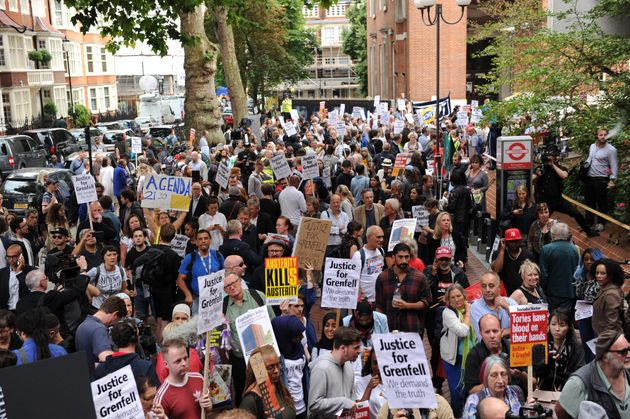 Hundreds of protesters demanding justice for Grenfell Tower victims marched to Kensington town hall ahead...