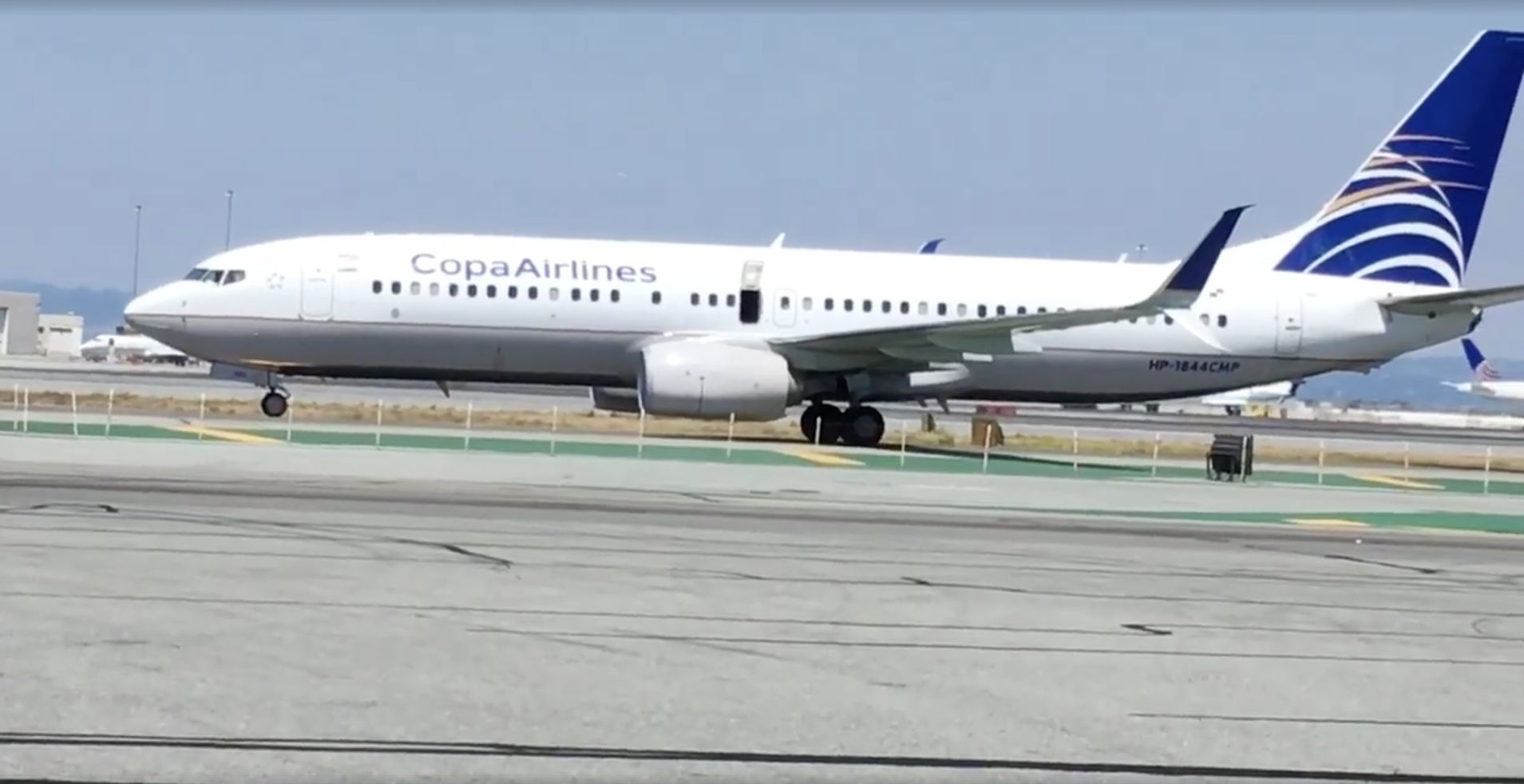 A Copa Airlines plane is seen with an emergency door open