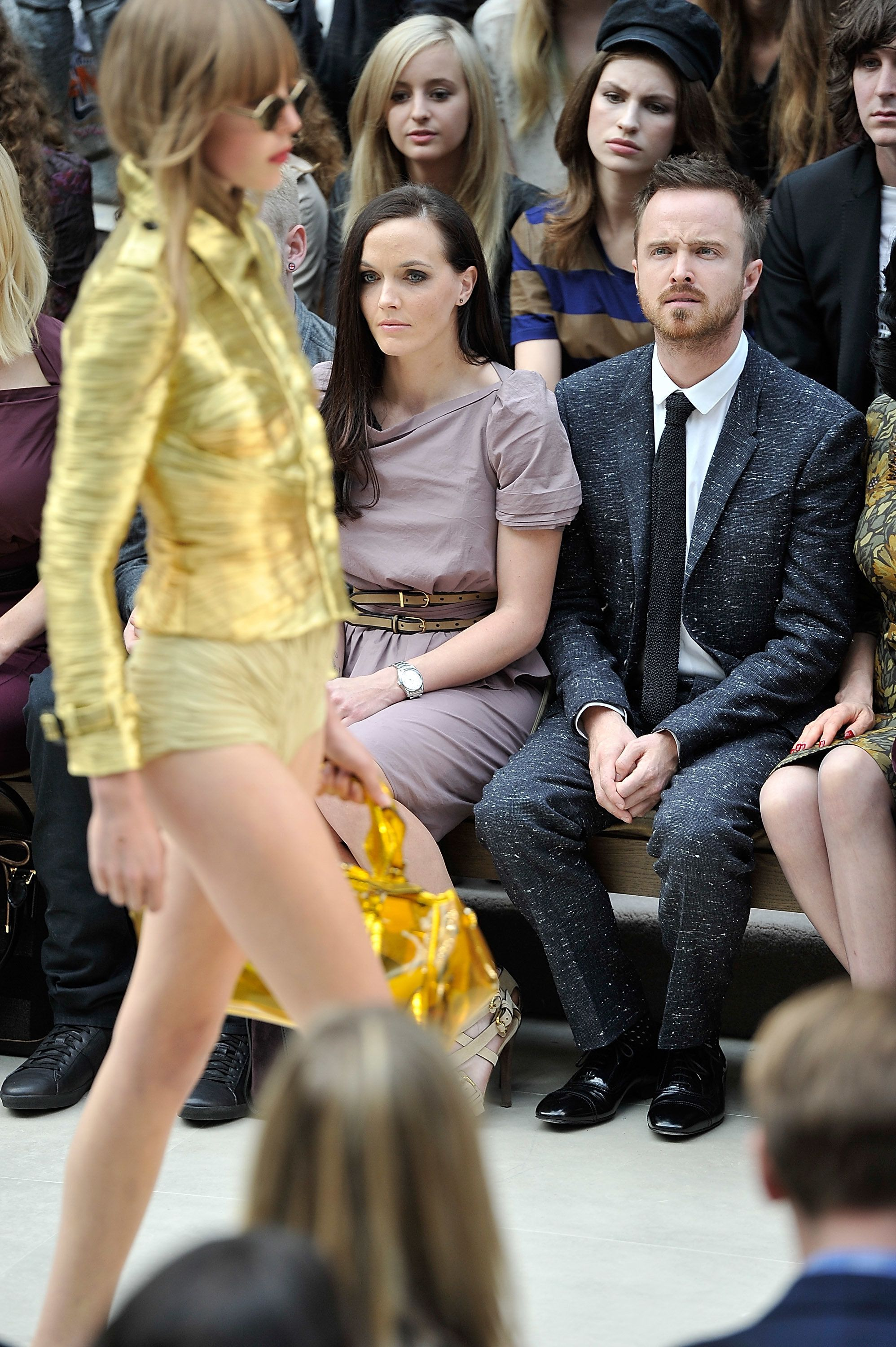 LONDON, ENGLAND - SEPTEMBER 17:  (L-R)  Victoria Pendleton and Aaron Paul, attend the Burberry Spring Summer 2013 Womenswear Show - Front Row at Kensington Gardens on September 17, 2012 in London, England.  (Photo by Gareth Cattermole/Getty Images for Burberry)