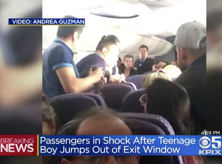 People are seen looking out of an open emergency exit door on a Copa Airlines flight into San Francisco on Tuesday.