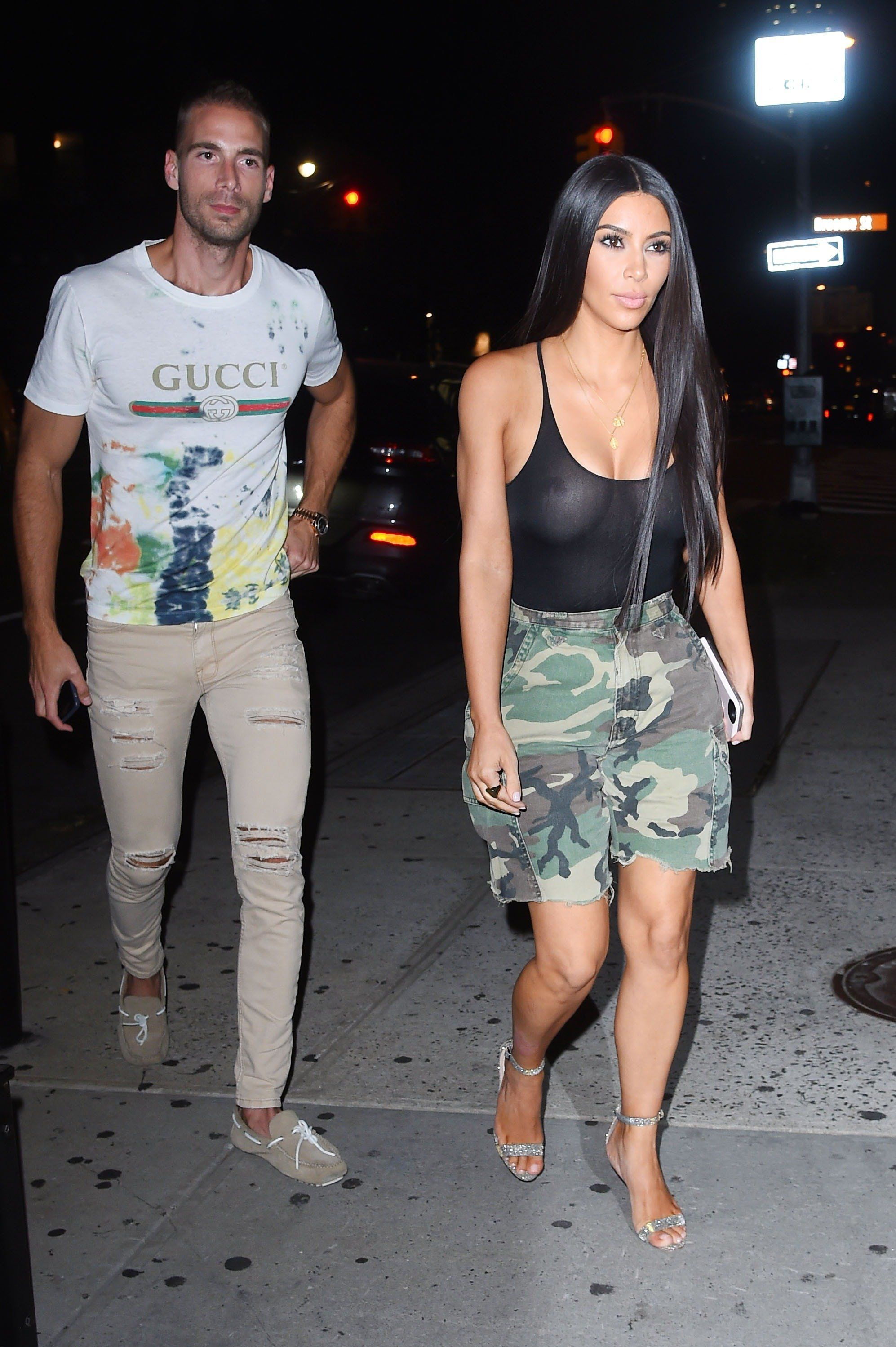 NEW YORK - AUGUST 01: Kim Kardashian and Kendall Jenner shop East Village thrift stores with there 2 bodyguards as Kim displays her chest in a see through tank top with army fatigue shorts on August 01, 2017 in New York, New York.  (Photo by Josiah Kamau/BuzzFoto via Getty Images)
