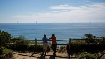 NEW SHOREHAM, RI - SEPTEMBER 22:  Tourists look out over the GE-Alstom Block Island Wind Farm stands 3 miles off of Block Island on September 22, 2016 New Shoreham, Rhode Island. The five 6-megawatt wind turbines are expected to produce more energy than Block Island needs. (Photo by Scott Eisen/Getty Images)