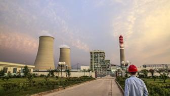 A Chinese worker walks along a path at the Sahiwal coal power plant, owned by China's state-owned Huaneng Shandong Rui Group, in Sahiwal, Punjab, Pakistan, on Wednesday, June 14, 2017. Pakistan is racing to bridge its power supply gap before national elections next year after a series of widespread blackouts highlighted the fragility of the network and its negative pull on South Asias second largest economy. Photographer: Asad Zaidi/Bloomberg via Getty Images