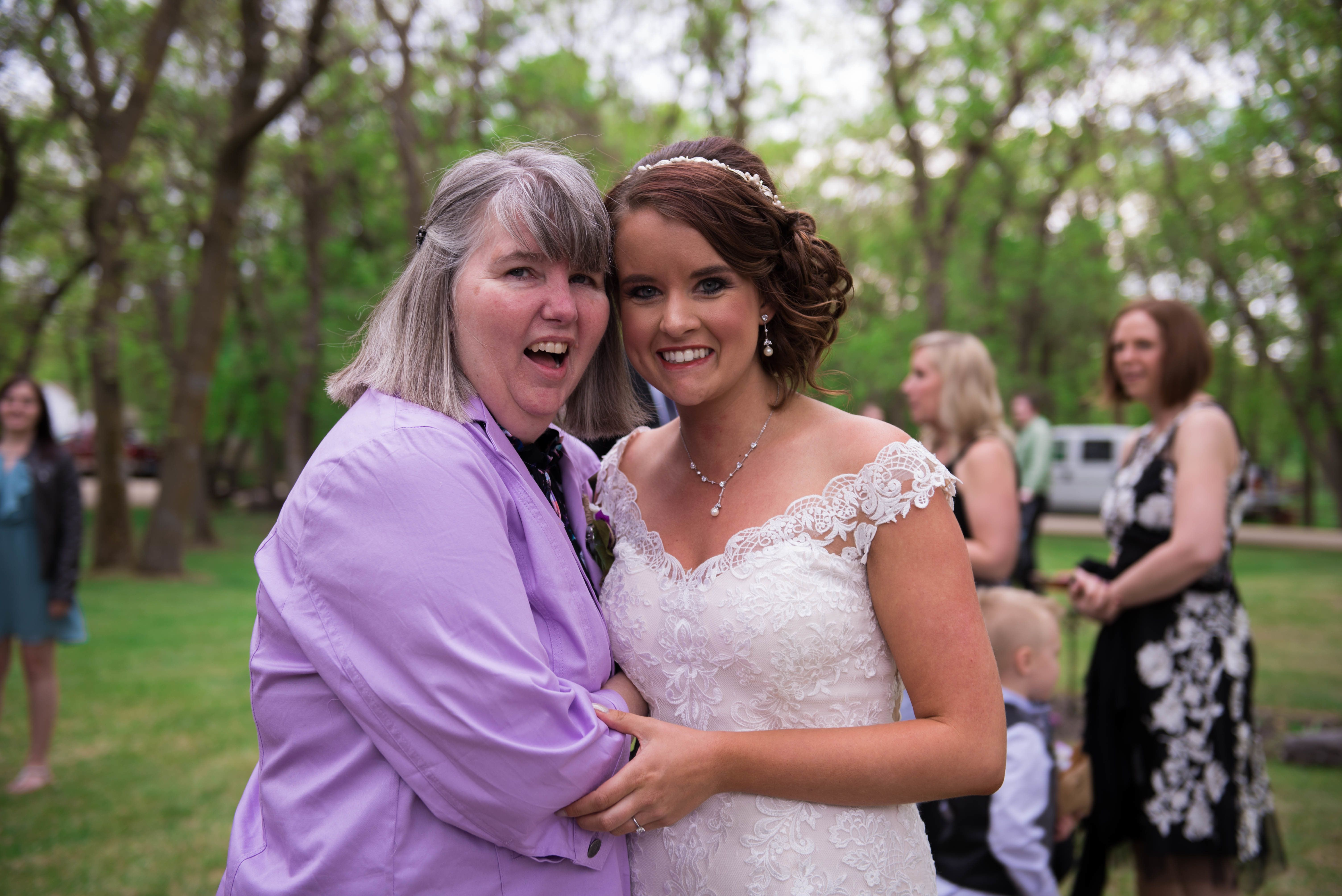 Stephanie Gefroh poses with her mom on her wedding day.