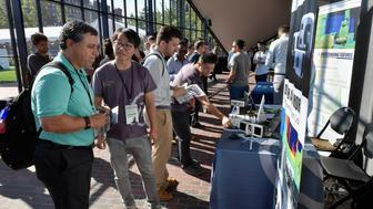 CAMBRIDGE, MA - JULY 17:  Attendees visit sponsor booths at the TechCrunch Sessions: Robotics at Kresge Auditorium on July 17, 2017 in Cambridge, Massachusetts. TechCrunch Sessions: Robotics is a single-day event designed to facilitate in-depth conversation and networking with the technologists, researchers and students of the robotics community as well as the founders and investors and was attended by more than 700 people.  (Photo by Paul Marotta/Getty Images for TechCrunch)