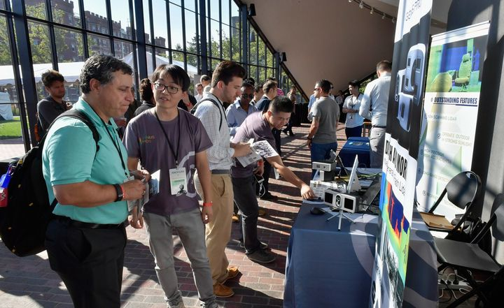 Attendees visit sponsor booths at the TechCrunch Sessions: Robotics at Kresge Auditorium on July 17, 2017 in Cambridge, Massa