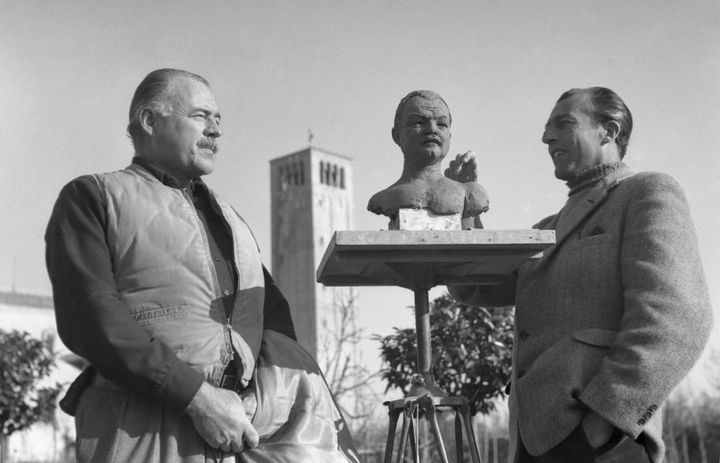 Ernest Hemingway posing for the sculptor Toni Lucarda, preparing a bust sculpture, in Torcello, Italy, 1948.
