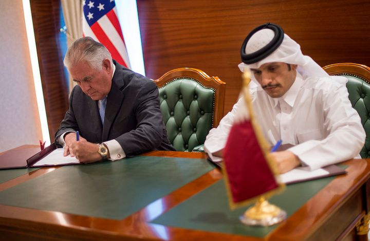 US Secretary of State Rex Tillerson and Qatari Foreign Minister Mohammed Al Thani sign a memorandum of understanding, <a rel=
