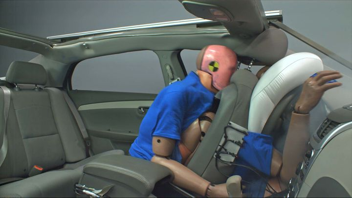 This image from a crash test shows what happens in a 35 mph collision when a passenger in the back is unbelted. The rear-seat