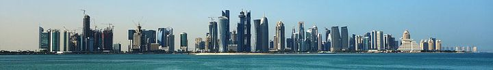 "Skyline of Doha, the capital of Qatar, <a rel=""nofollow"" href=""https://en.wikipedia.org/wiki/File:Doha_banner.jpg"" target=""_b"