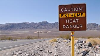 Extreme heat warning sign in Death Valley National Park in California.