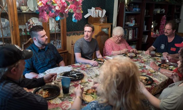 Mark Zuckerberg dines with a family in