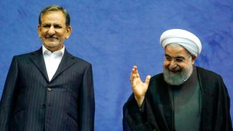 Iranian President and presidential candidate Hassan Rouhani (R), along with current vice-president and presidential candidate Eshaq Jahangiri, attend a campaign rally for the upcoming presidential elections in the capital Tehran on May 13, 2017. / AFP PHOTO / ATTA KENARE        (Photo credit should read ATTA KENARE/AFP/Getty Images)