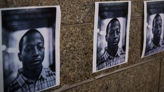 Pictures of Kalief Browder are attached to a wall in New York June 11, 2015. New York City Mayor Bill de Blasio on Monday vowed to push reforms at the city's troubled Rikers Island prison complex after the reported weekend suicide of the 22-year-old Browder who had been held there for three years without being convicted of a crime. REUTERS/Lucas Jackson
