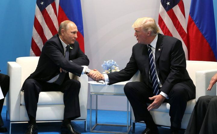 Russian President Vladimir Putin and U.S. President Donald Trump shake hands during a bilateral meeting on the sidelines of t