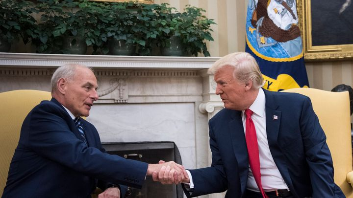 New White House Chief of Staff John Kelly and President Donald Trump shake hands after being privately sworn in during a cere