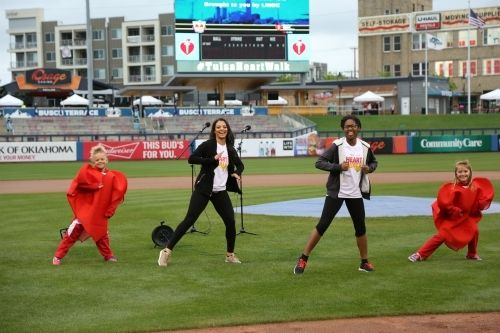 <p>Triana, second from left, leading warm-up for 2017 Tulsa Heart Walk.</p>