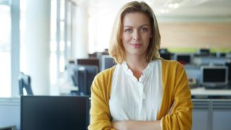 Portrait of a businesswoman standing with her arms folded in the office