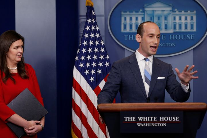 White House senior policy adviser Stephen Miller, right, addresses reporters on Aug. 2, 2017, as press secretary Sarah Huckab
