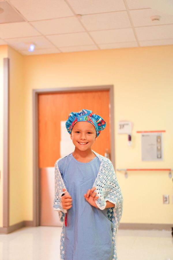 """""""When Aniyah had her central line removed, she wrapped up in her favorite blanket before the procedure. You might call it her"""