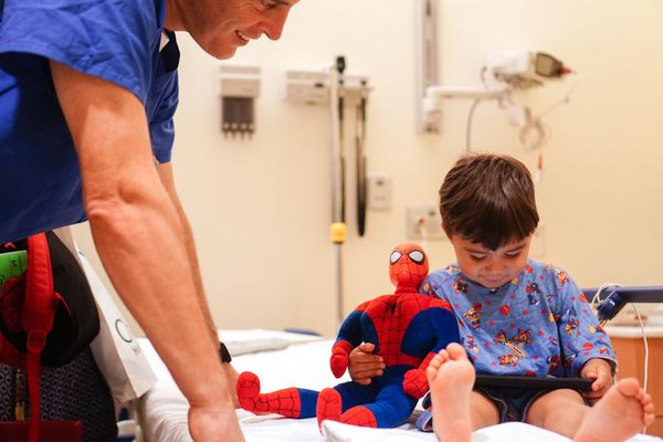 """""""Superheroes are always on the job. Spider-Man stuck by Miguel during surgery for laryngomalacia."""""""