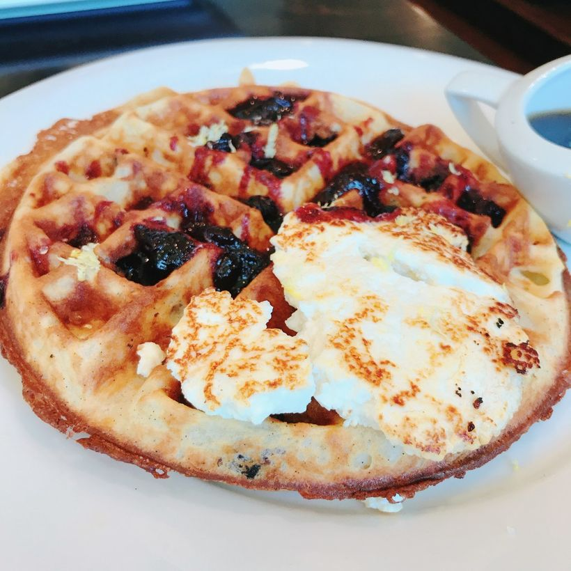 This may just be the best blueberry waffle we have ever had. A vanilla waffle is speckled then topped with crushed blueberrie