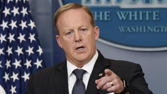 Sean Spicer, White House press secretary, takes a question during a White House press briefing in Washington, D.C., U.S., on Tuesday, May 30, 2017. PresidentDonald Trumpblasted Germany anew over trade and defense, ratcheting up a dispute with ChancellorAngela Merkelthat risks getting personal and undermining a trans-Atlantic bond that is the bedrock of U.S.-European relations. Photographer: Olivier Douliery/Bloomberg via Getty Images