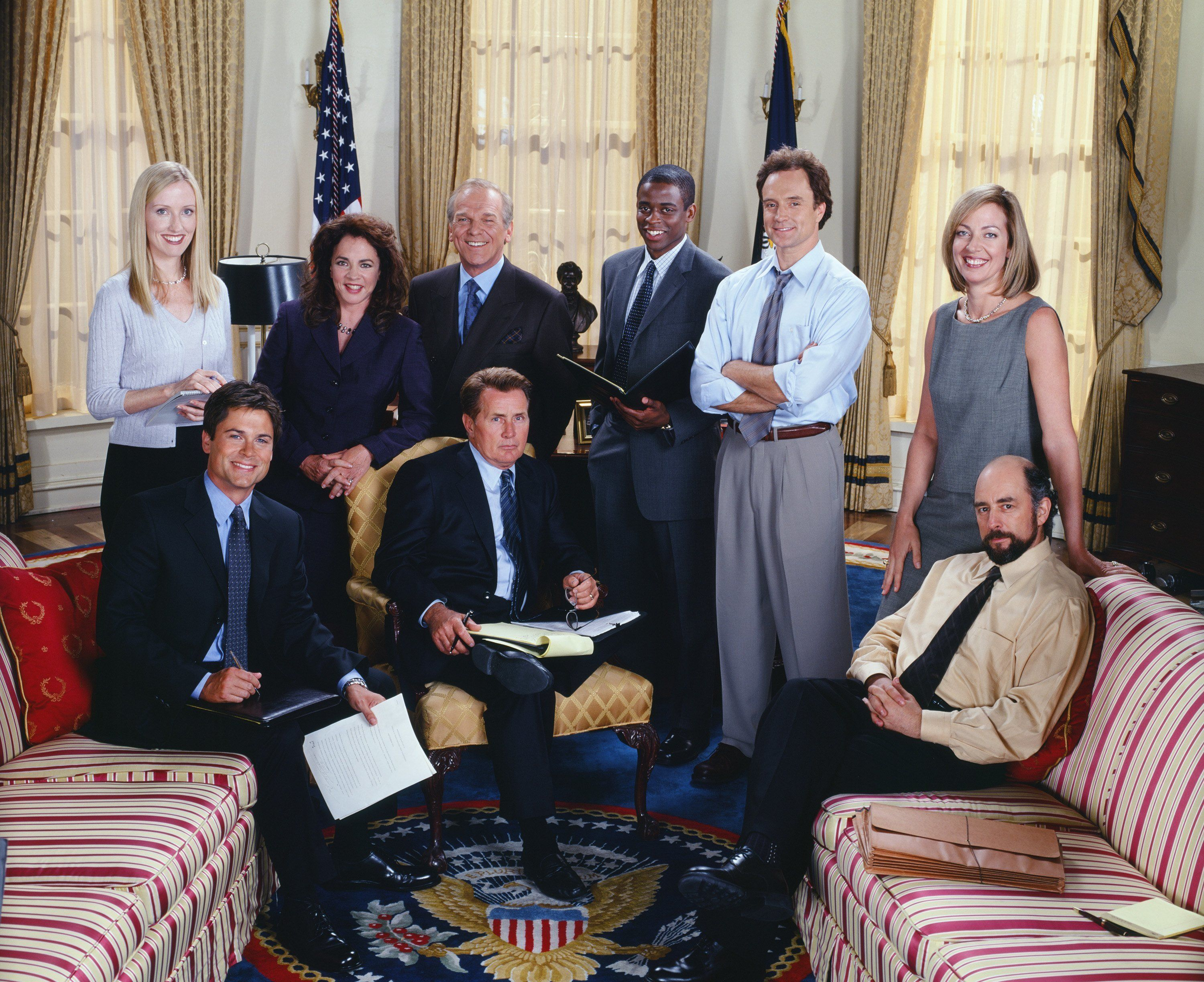 THE WEST WING -- SEASON 3 -- Pictured: (l-r) Janel Moloney as Donna Moss, Rob Lowe as Sam Seaborn, Stockard Channing as Abbey Bartlet, Martin Sheen as President Josiah 'Jed' Bartlet, John Spencer as Leo McGarry, Dule Hill as Charlie Young, Bradley Whitford as Josh Lyman, Allison Janney as Claudia Jean 'C.J.' Cregg, Richard Schiff as Toby Ziegler -- Photo by: James Sorensen/NBCU Photo Bank