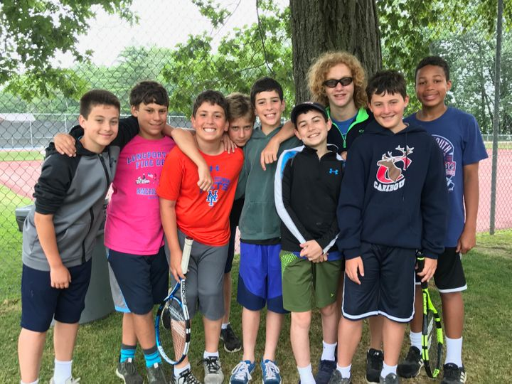 It's easy to embody the value of Friendship with friends like these! Daniel (center - grey sweatshirt, blue shorts) with his