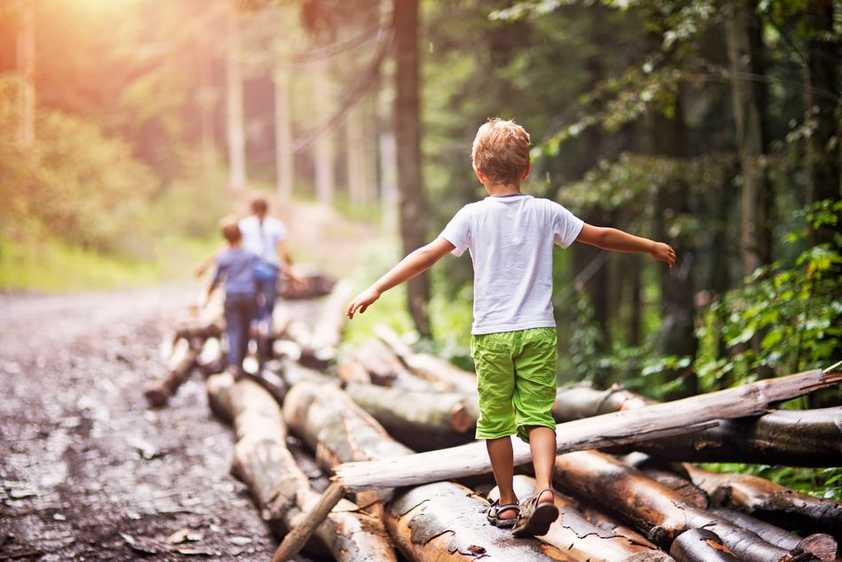 Children love places to clamber over like a rocky beach or challenges like climbing trees or jumping over streams. Challenge children to touch that tree and run back, hopscotch between the pavement cracks or run along the low wall.