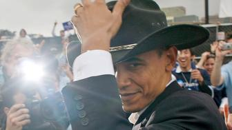 AUSTIN, TX - FEBRUARY 23:  (ALTERNATE CROP) U.S. Sen. Barack Obama (D-IL) wears a cowboy hat offered by a supporter after speaking at an outdoor rally February 23, 2007 in Austin, Texas. Obama, who is seeking the Democratic presidential nomination in 2008, told more than 10,000 people that it's time to end the war in Iraq and to turn the nation's attention to education and health care.  (Photo by Ben Sklar/Getty Images)